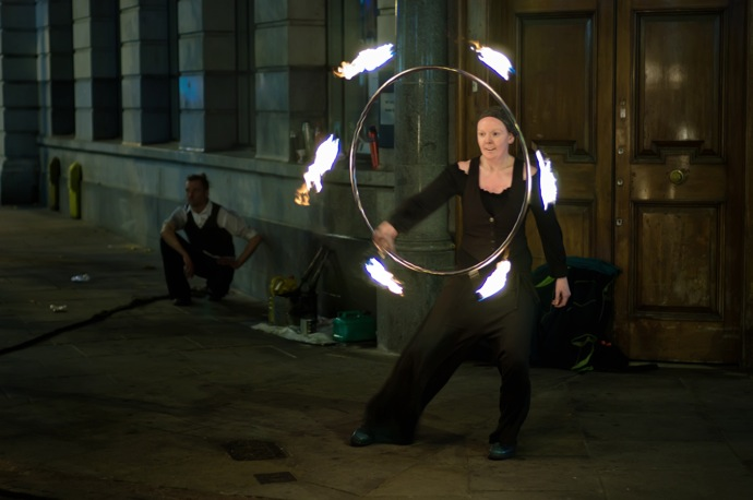 Street performer with hoop of fire